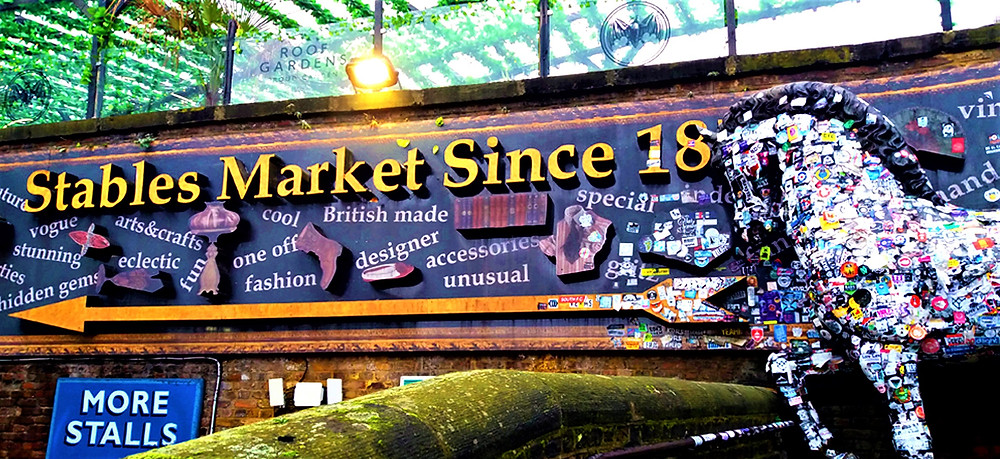Camden Town's Stables Market in Chalk Farm Rd, featuring over a thousand unique stalls for antique, vintage & alternative furniture, clothing and goods.