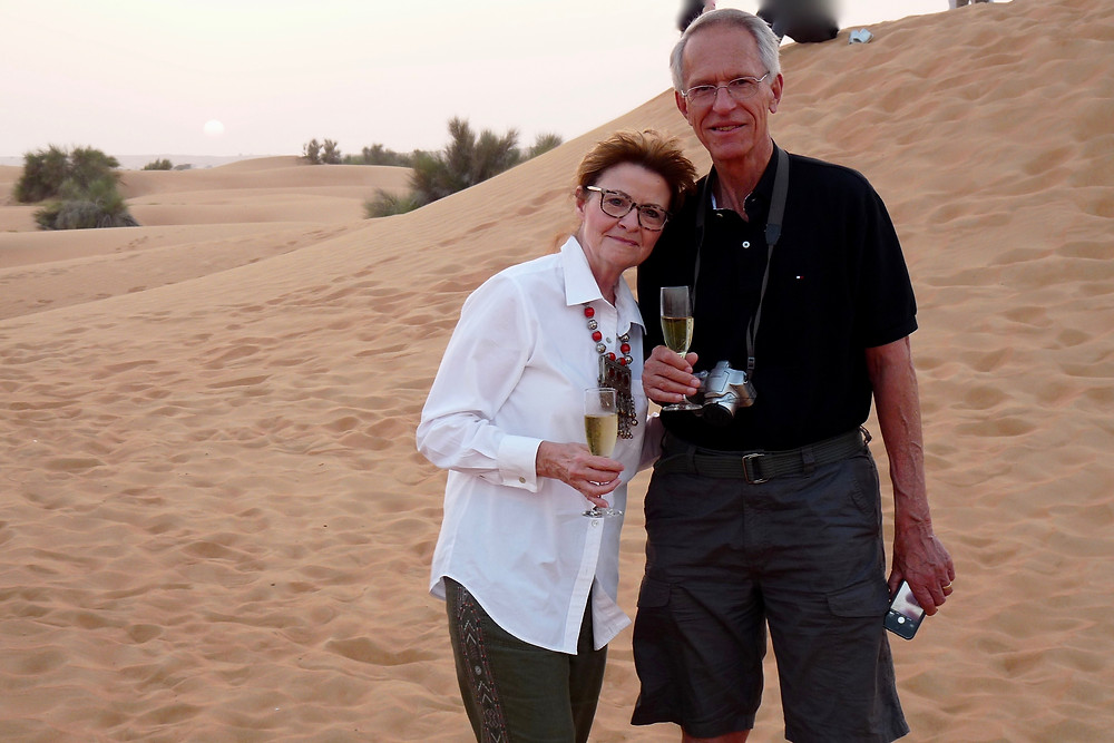 Al Scheck & Vicki Scheck enjoy sundowner in the desert, Al Maha Resort