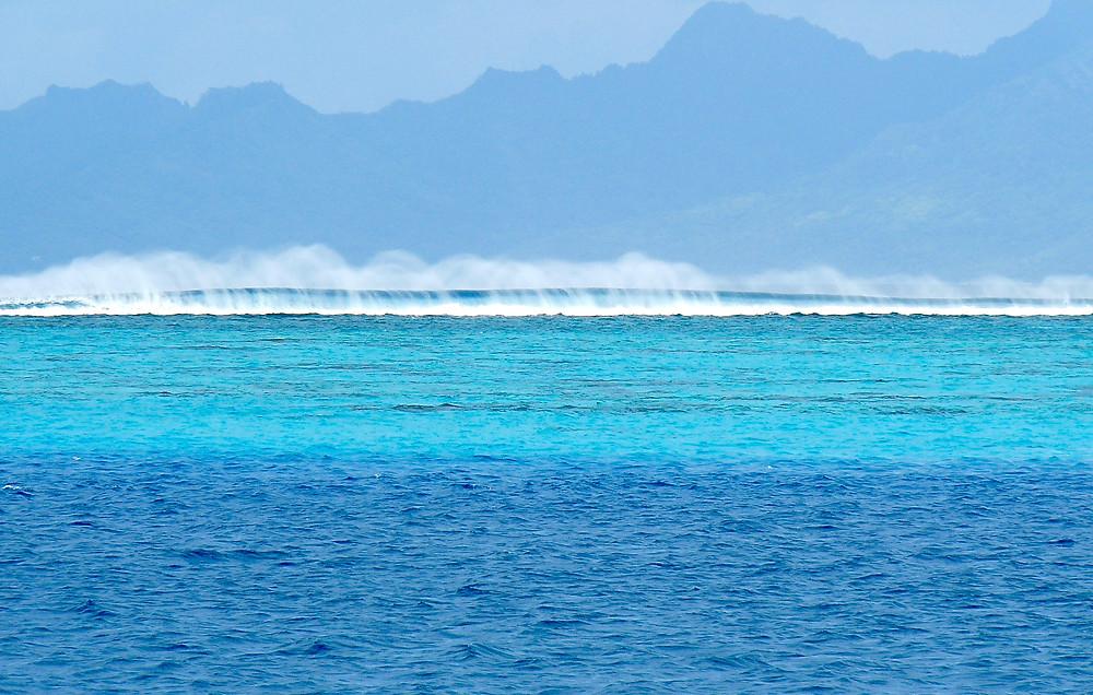 Multi-hued water & high spray at the Tahiti InterContinental