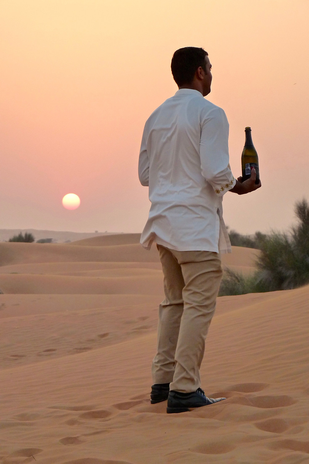 Champagne server in the desert at sunset, Al Maha