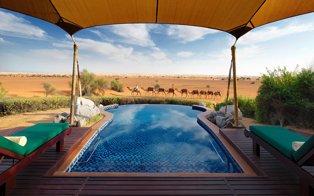 Camel caravan, desert, luxury tent & plunge pool at Al Maha