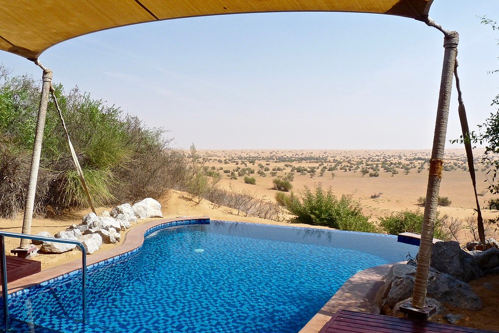Private infinity plunge pool overlooks desert at Al Maha