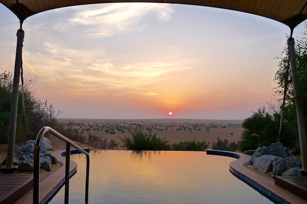 Sunrise over desert & plunge pool at Al Maha, Dubai