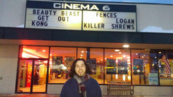 In front of the marquee