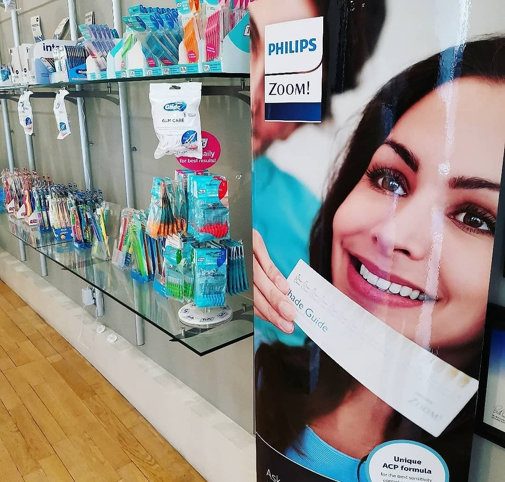Philips ZOOM Teeth Whitening poster and dental products available at dental practice