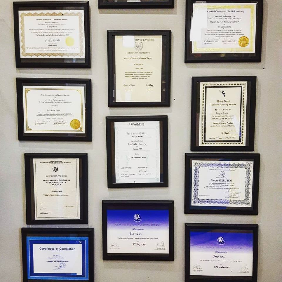 Image of Dr Rikhi's Dental Certificates - hanging on a wall within Aromaden Dental Practice