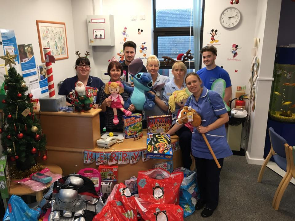 Andrew and Jack delivery presents to Dewsbury Hospital