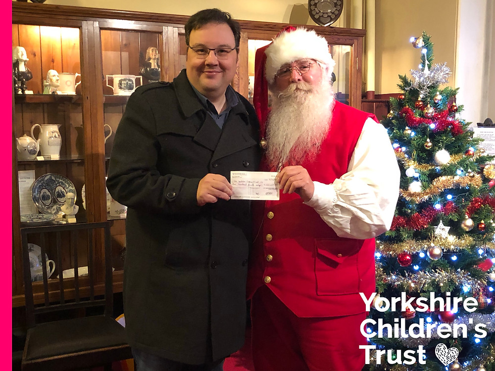 Santa Blake presents a cheque from 5th Darlington Scouts for Yorkshire Childrens Trust