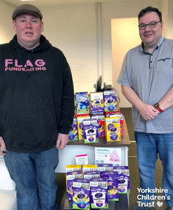 FLAG fundraising donating Easter Eggs to Yorkshire Children's Trust, a local charity, helping local children.