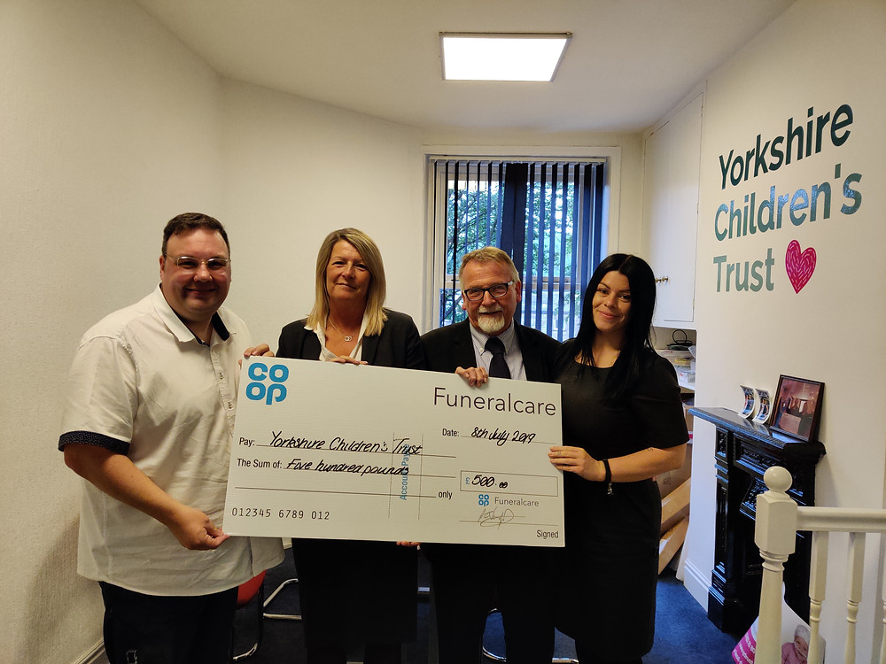 Kevin Mitchell and Co-op Funeral Care donating to Yorkshire Children's Trust, a local charity, helping local children in Yorkshire region