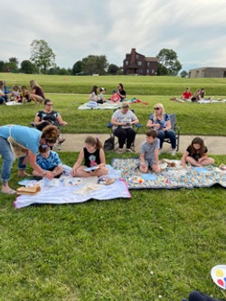 Children Painting with adults watching
