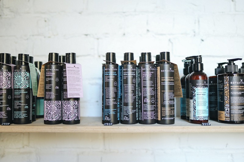 Black Shampoo Bottles on Shelf