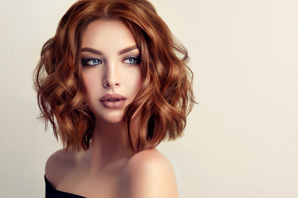 Lady with Short Wavy Red Hair