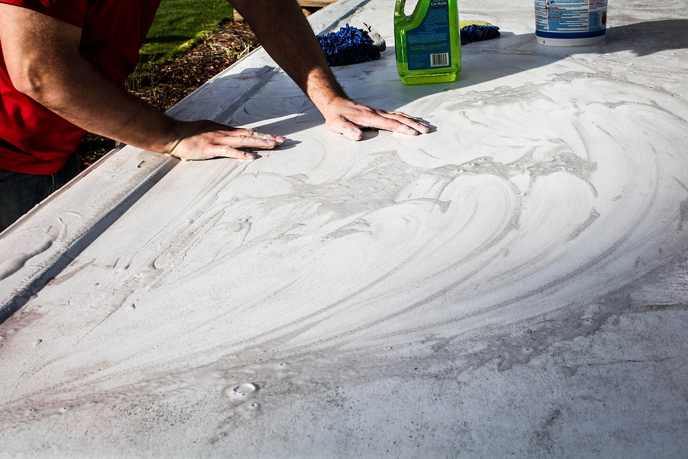 Pressure Washing- cleaning the grime off the top of our Coleman pop up tent trailer using Mr. Clean Magic Erasers. by JeJe Design