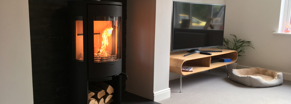 Contura Wood Burner in a redesigned fireplace with slate tile backing