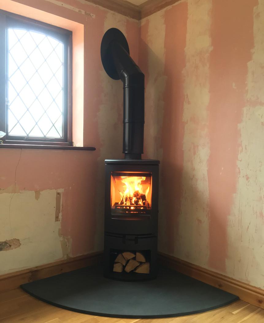 Corner stove (room undecorated!)