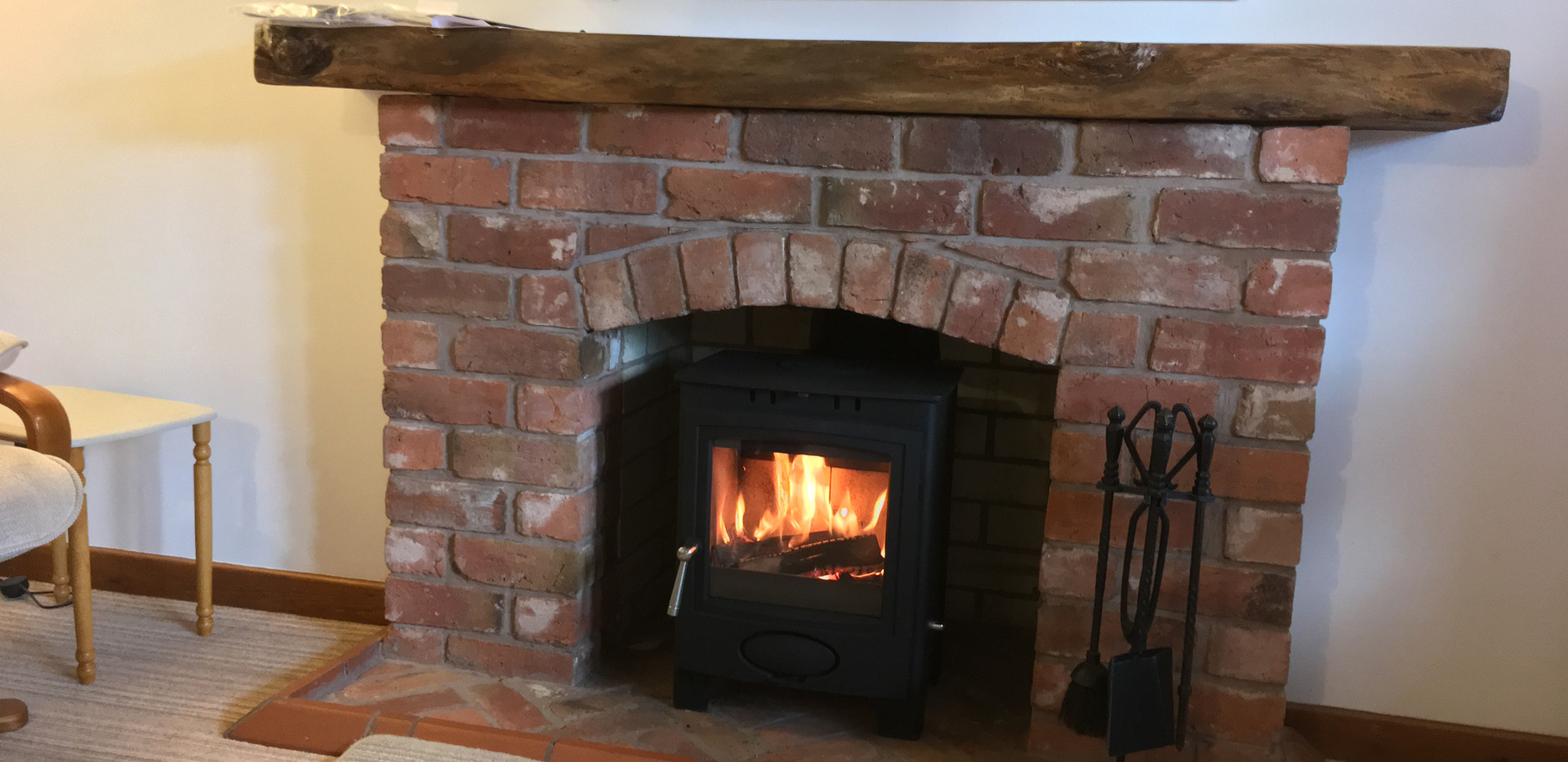 Stove to brick fireplace