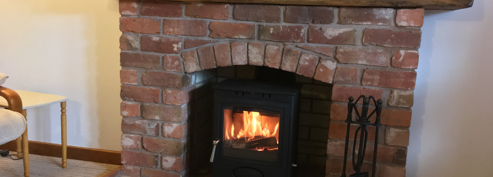Stove to brick fireplace