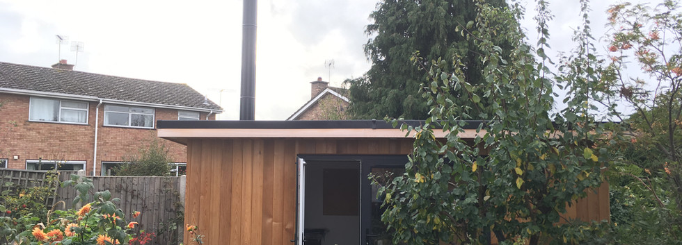 Garden room with stove and flue