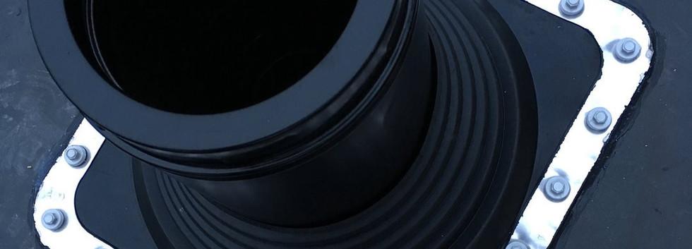Flue installation through flat rubber roof
