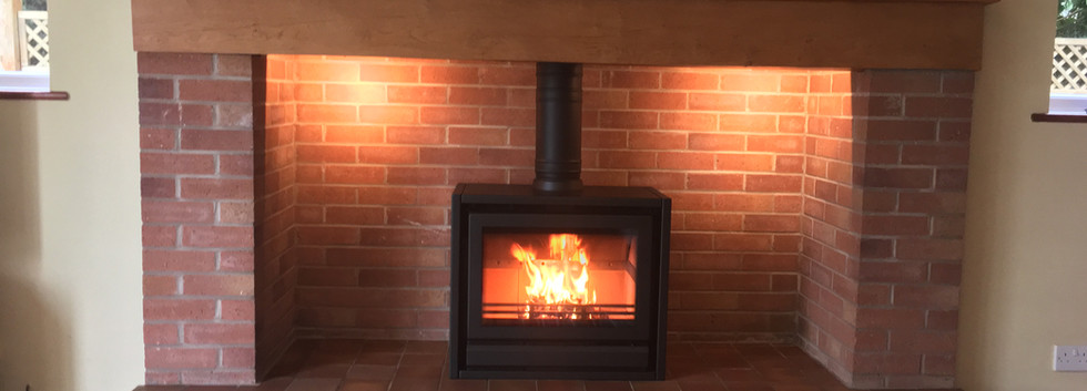Large fireplace with wood burner