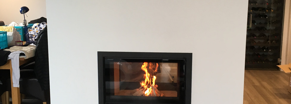 Double sided inset woodburner and false chimney breast