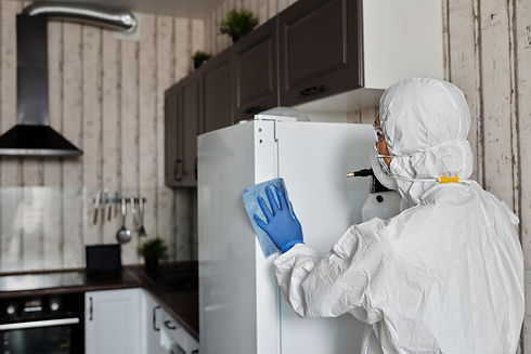 person-in-a-protective-suit-disinfecting