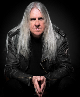 Legendary Saxon Frontman Launches Video For SCHOOL OF HARD KNOCKS