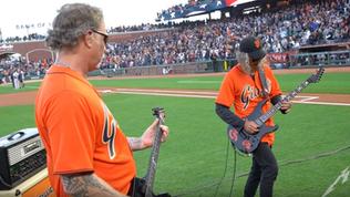 "James Hetfield and Kirk Hammett performing ""The Star-Spangled Banner"""
