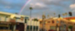 javista coffee bar under a rainbow sky