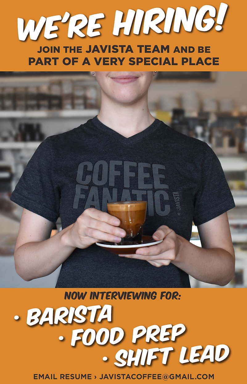 barista holding an espresso