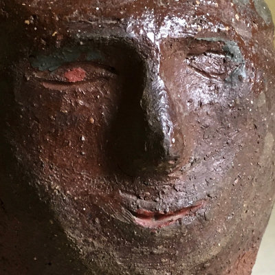 Painted Redware Portrait of Man With Half Smile