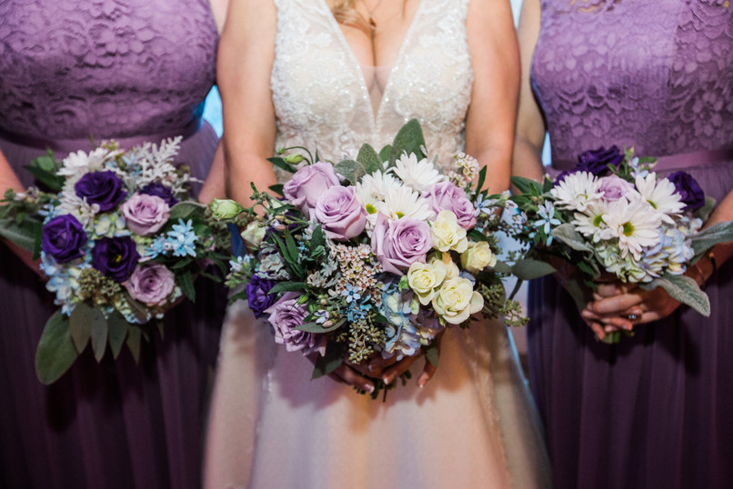 Lavender and blue bouquets with daisies