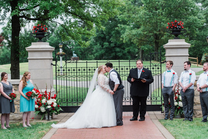 Red and white ceremony urns