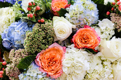 Detail of coral and blue wedding flowers