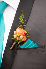 Coral spray rose boutonniere
