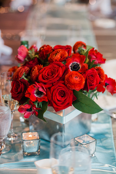 Red rose, ranunculus and anemone centerpiece