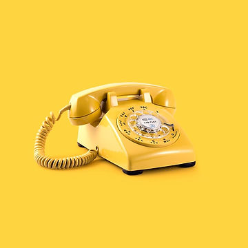 Yellow telephone against a yellow background: Photo by Mike Meyers on Unsplash