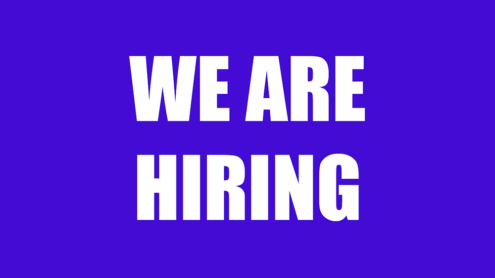 """Purple rectangle with text """"We are hiring"""""""