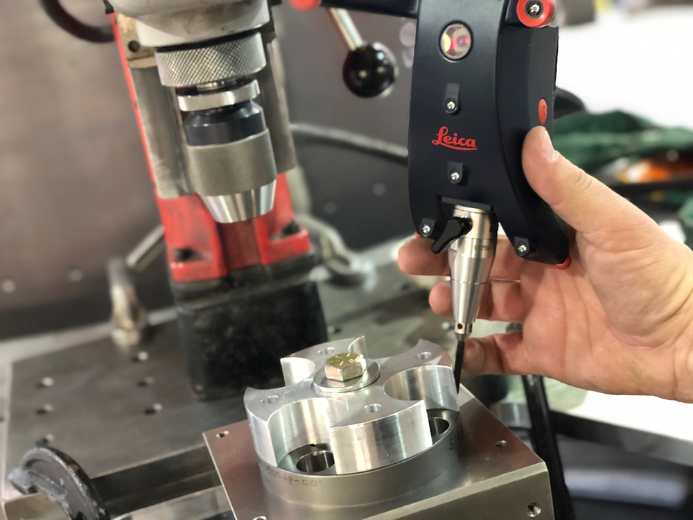 Measuring objects with precision on the order of 1/10,000 of an inch using advanced laser tracking