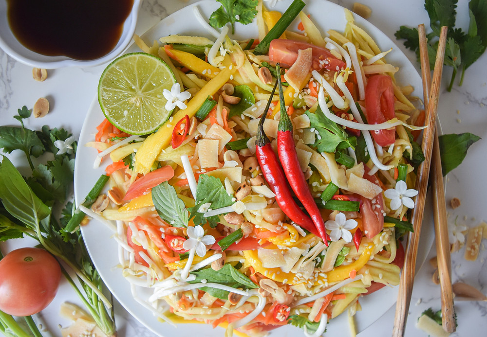 This authentic Thai dish is filling, delicious and super simple! It's raw, vegan and gluten-free - serving as a super healthy (and yummy) plant-based meal. It takes just 20 minutes to make - convenient when you're in a time crunch or meal-prepping. Head to your closest asian market / grocery store to find green mangos and Thai basil and enjoy this exotic taste of Thailand!