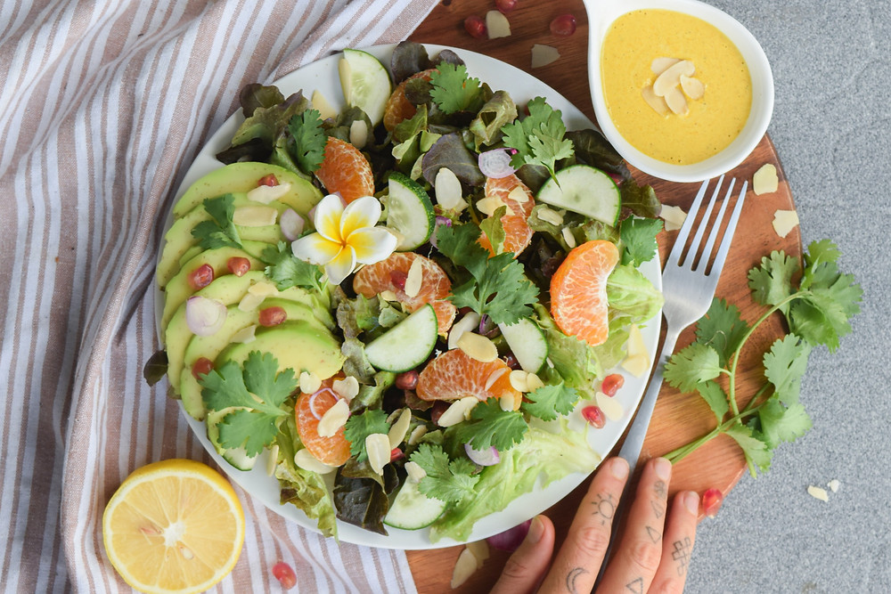 This easy to make vegan citrus salad is refreshing and light - yet satisfying! Loaded with fresh greens, herbs, almonds, avocado, orange slices and pomegranate seeds - YUM! Pair it with this lemon, ginger and turmeric dressing recipe for an extra zing of flavor. This salad variation will quickly become a new go-to favorite!