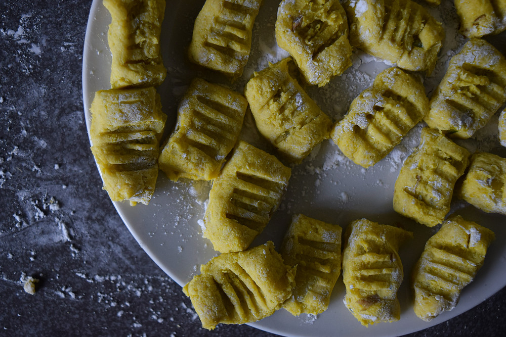 This homemade pumpkin and potato gnocchi is easy to make, delicious, and satisfying. It take's a bit of preparation but it's worth it! Steam the vegetables, create the dough, boil the gnocchi then sear with a cashew cream sauce. A plant-based, vegan, gluten-free variation that's sure to leave you in the best kind of food coma.