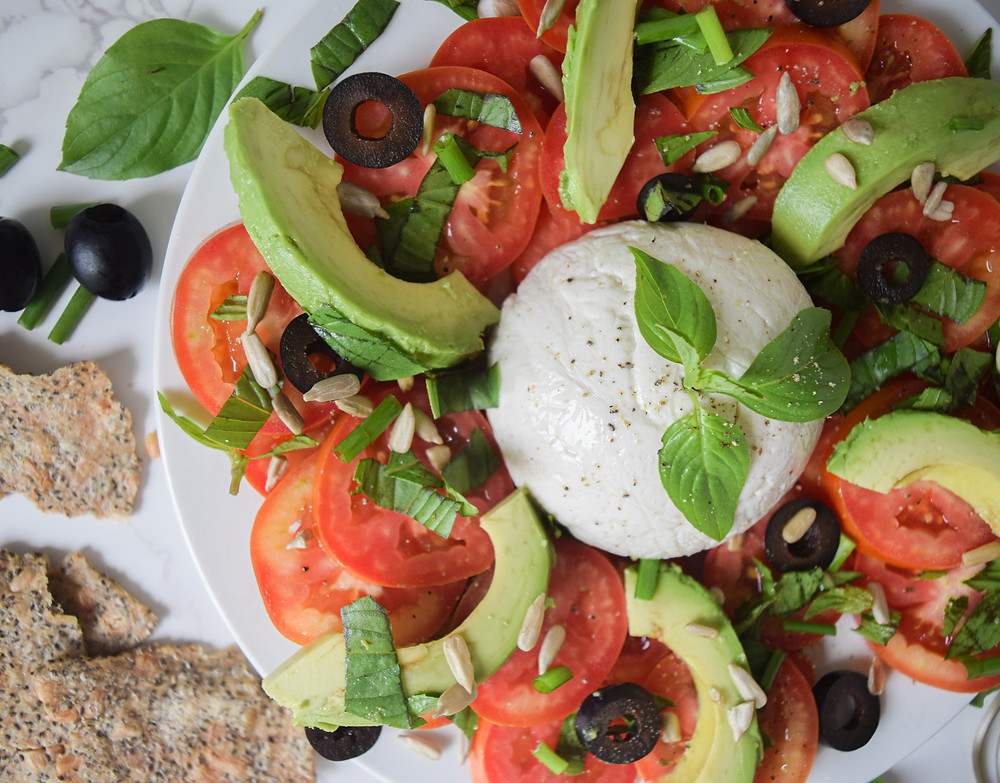 Love a light and refreshing caprese salad? Try my recipe that adds some additional toppings to the traditional tomato, basil, mozzarella. It's filling, fresh, and simple to prepare! It's a plant-based, healthy meal idea that the whole family will love! Lunch or dinner, it's a quick 15 minute meal to turn to!