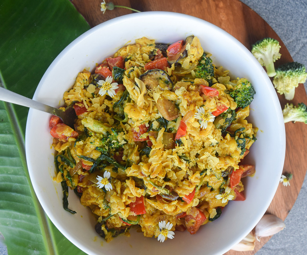 Yes - finally - a satisfying vegan & gluten-free Mac & Cheeze recipe you can feel good about eating! Enjoy feeding your inner child, or feel good about serving your kids this family favorite. Whole, real and fresh ingredients! Use chickpea pasta as a great gluten-free alternative and less bloat. Add veggies to this Mac & Cheeze for bonus nutrition and next level deliciousness. The creamy cheese sauce is plant-based, made from coconut milk, tapioca, nutritional yeast and spices. This recipe is a healthy go-to when I'm looking for something filling, comforting, and quick! Make in less than 30 minutes!