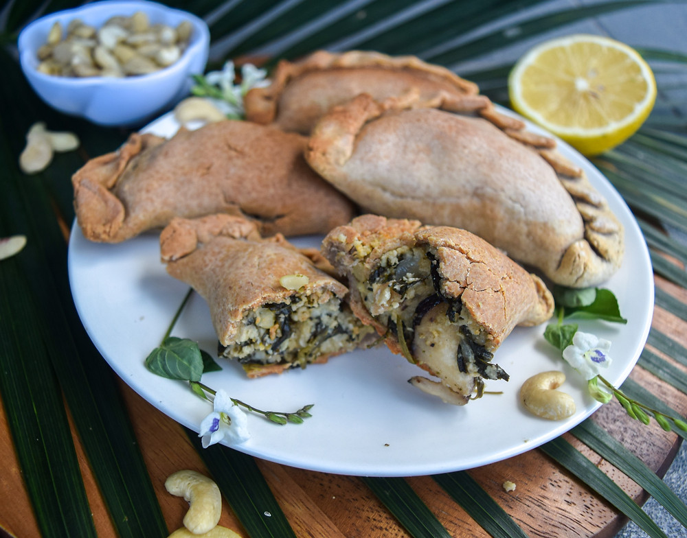 Who's in the mood for empanadas? Try my vegan, gluten-free, baked not fried, spinach & cashew cheese empanada recipe! A creative twist to the traditional South American cuisine - inspired by my travels throughout SA. They are filling and delicious! A crunchy outside and a cheezy-creamy-healthy inside! Meet you in the kitchen... let's get cooking! YUM!