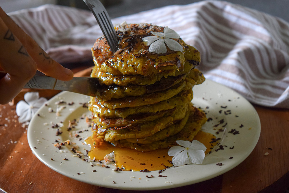 Start your morning with delicious plant-based, gluten-free pancakes! Made with pumpkin, buckwheat flour, coconut milk and warm and comforting spices! This stack is fluffy, moist, satisfying, and healthy. Add your favorite toppings and drizzle with maple  syrup or honey. It's an easy recipe to up-level those special mornings that are calling for vegan pancakes!