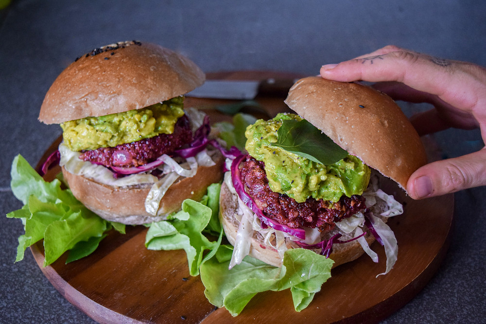These delicious plant-based burgers really give you something to sink your teeth into. They are vegan, gluten-free, nutritious and nutrient dense! They are simple and easy to make. Use quinoa, beetroot, and sautéed onion for the patty along with spices for a burst of flavor. You can sauté or bake the patty to perfection. Add your favorite 'burger' toppings like avocado, lettuce, slaw, fresh herbs... These burgers are a meal everyone (plant-based or not) can enjoy, because yum!