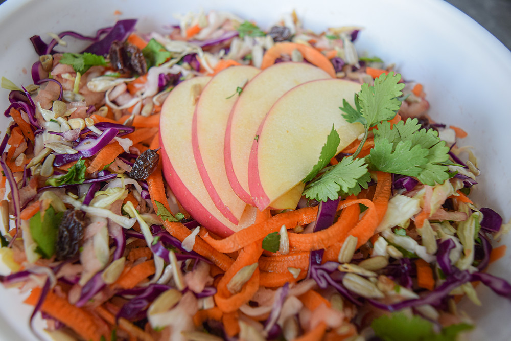 Eat the rainbow! This delicious raw-vegan slaw recipe combines sweet and savory perfectly! Get your fix of colorful vegetables to boost vitality! Combined with sweet apple, raisins, sun flower seeds, herbs and vinaigrette, this salad may quickly become one of your favorites! It's a filling meal, starter, side dish, or nice to share with friends/family!