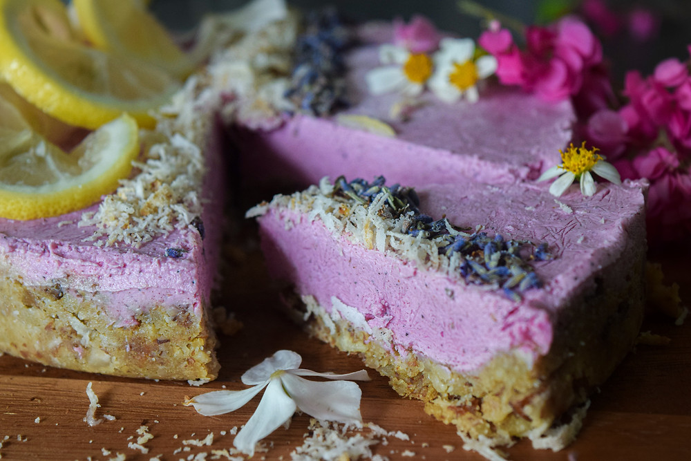 Pretty and pink! This raw cake is simple to make yet will leave people thinking you're a culinary genius! Healthy, simple and wholesome ingredients. Decorate with your favorite fruits, flowers, coconut shreds, etc. to make it unique to your special occasion. It's not overly sweet, so you can enjoy at any time!